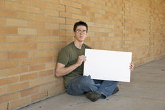 Teenager with blank sign. Teenager holds up blank sign Stock Photography