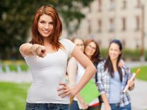 Teenager in blank white t-shirt pointing at you. Gestures and people concept - happy teenager in blank white t-shirt pointing at you Royalty Free Stock Images