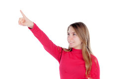 Teenager blonde girl in red indicating something with her finger Stock Photos
