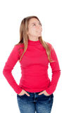 Teenager blonde girl in red looking up Stock Image