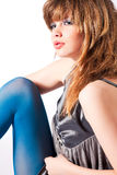 Teenager in blue pantyhose and grey blouse thinkin Stock Photo