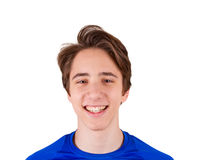 Teenager in blue T-shirt, isolated on white background. Young man portrait Royalty Free Stock Photos
