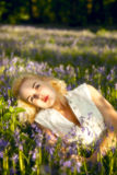 Teenager in Bluebells. Beautiful blonde teenager in Bluebell wood at sunset stock photography
