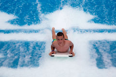 Teenager Body Boarding royalty free stock photography