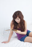 Teenager with book. At home Stock Photo