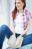Teenager with book Stock Image