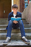Teenager with the Book outdoor Royalty Free Stock Photography