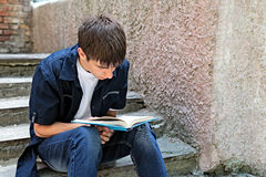 Teenager with the Book outdoor Royalty Free Stock Photos