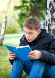 Teenager with the Book Royalty Free Stock Photo