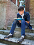 Teenager with a Book Royalty Free Stock Images