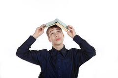 Teenager with book on white background Royalty Free Stock Images