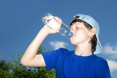 Teenager with bottle Stock Photography