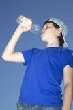 Teenager with bottle Royalty Free Stock Images
