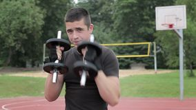 Teenager boxing with dumbbells at outdoor stock video footage