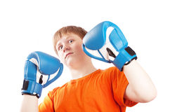 Teenager in boxing gloves Stock Images