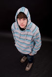 A teenager boy. In striped and hooded pullover royalty free stock photo