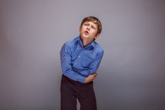 Teenager boy brown European appearance holds hands Royalty Free Stock Images