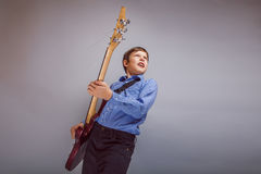 Teenager a boy brown European appearance playing Royalty Free Stock Photos