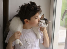 Teenager boy with cat on his shoulders close up photo Stock Photos