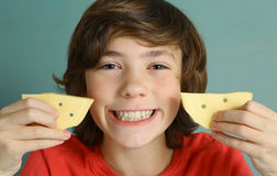 Teenager boy with cheese smile Stock Photography