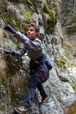 Teenager boy climbing Stock Images