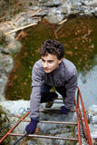 Teenager boy climbing Stock Photos