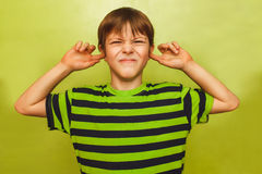 Teenager Boy Closed His Ears To The Sound Of A Stock Images