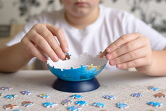 Teenager boy collects puzzles from Globe Stock Image