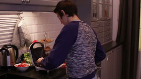 Teenager Boy Cooking Fried Bread stock footage