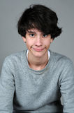 Teenager boy. Cute teenager boy on a gray background Royalty Free Stock Photography