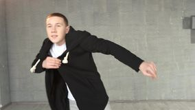 Teenager boy dancing hip-hop. Dynamics of modern dance movement stock footage