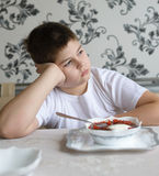 Teenager boy do not want to eat soup Royalty Free Stock Photography