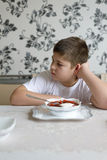 Teenager boy do not want to eat soup Royalty Free Stock Photo