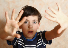 Teenager boy with fear expression and gesture Stock Photography