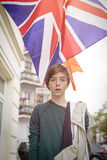 Teenager boy in front of the british union jac. Outdoor shot of a teenager boy in front of the british union jack Stock Photos