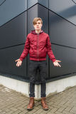 Teenager boy gesticulating doubt and question over urban backgro Stock Photo