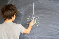 Teenager boy getting an idea. Teenager boy finding an idea - back to school education concept Royalty Free Stock Photo