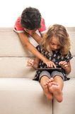 Teenager boy and girl playing on tablet Royalty Free Stock Photo