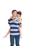 Teenager boy giving little girl  piggyback ride, Stock Image