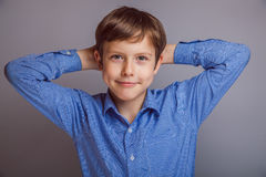 Teenager boy on a gray background Stock Images