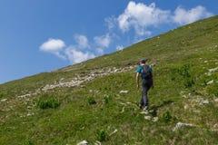 Teenager boy hiking Stock Photo