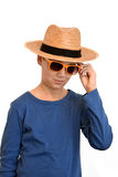 Teenager boy. Hip trendy teenage boy wearing straw hat and sunglasses stock image