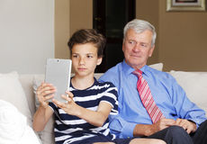 Teenager boy and his grandfather Royalty Free Stock Photos