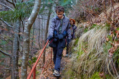 Teenager boy and his mother hiking Royalty Free Stock Photography