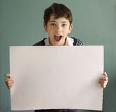 Teenager boy hold white empty blank paper sheet Royalty Free Stock Image