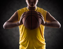 Teenager boy holding a basket ball Stock Image