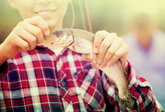 Teenager boy holding catch fish on hook Royalty Free Stock Photo
