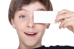 teenager boy holding a white piece of card Stock Photography