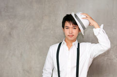 A teenager boy holds hat in his hand Stock Photo