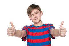 Teenager boy holds his thumbs up Stock Photography